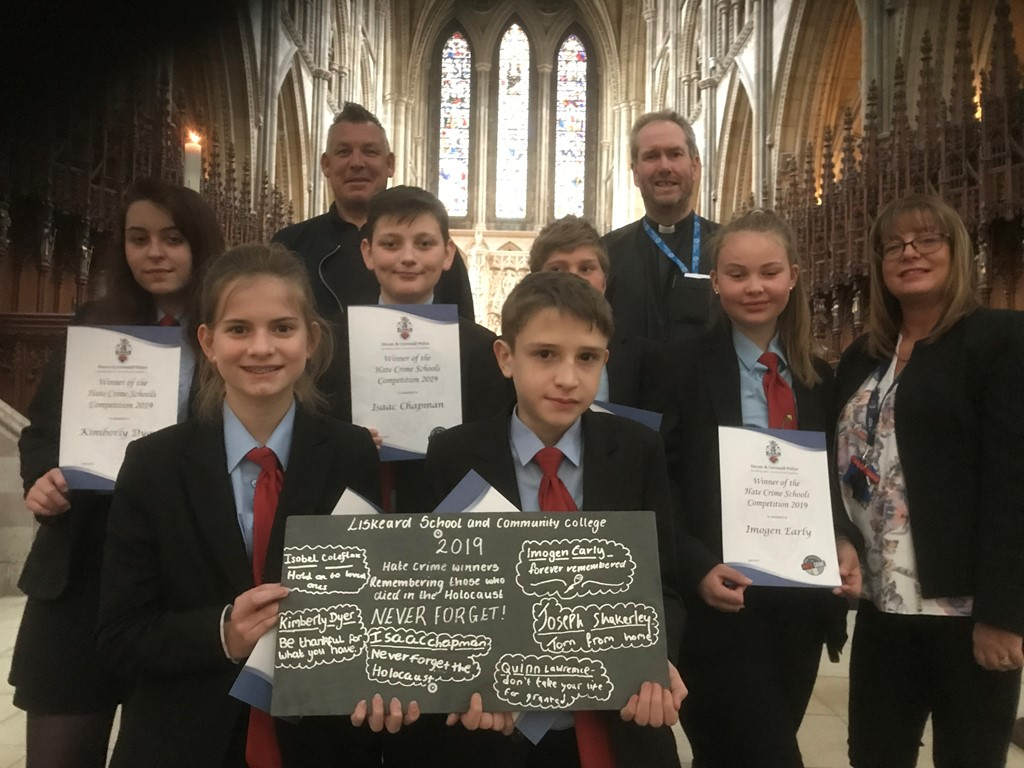 Rev'd Alan Bashforth of Truro Cathedral with teachers and pupils from Liskeard Community School holding up a roof slate with hand written messages