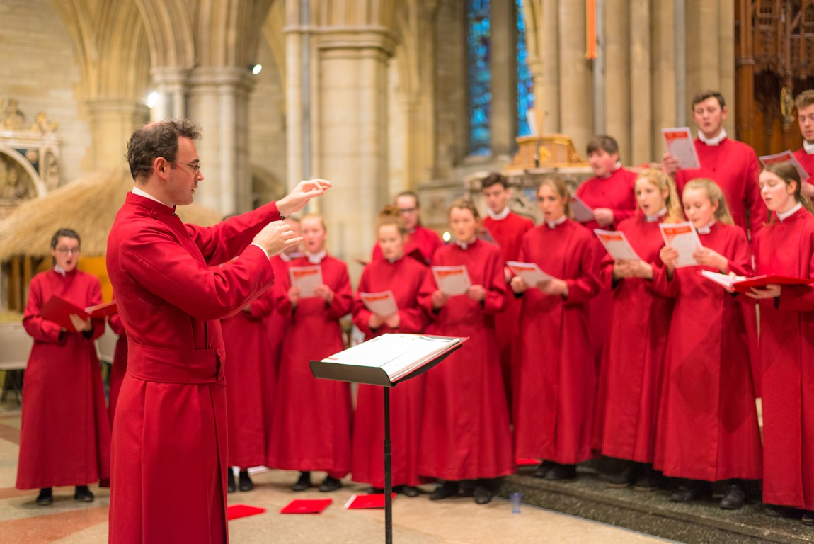 Director of Music Christopher Gray conducting the choir at Truro Cathedral