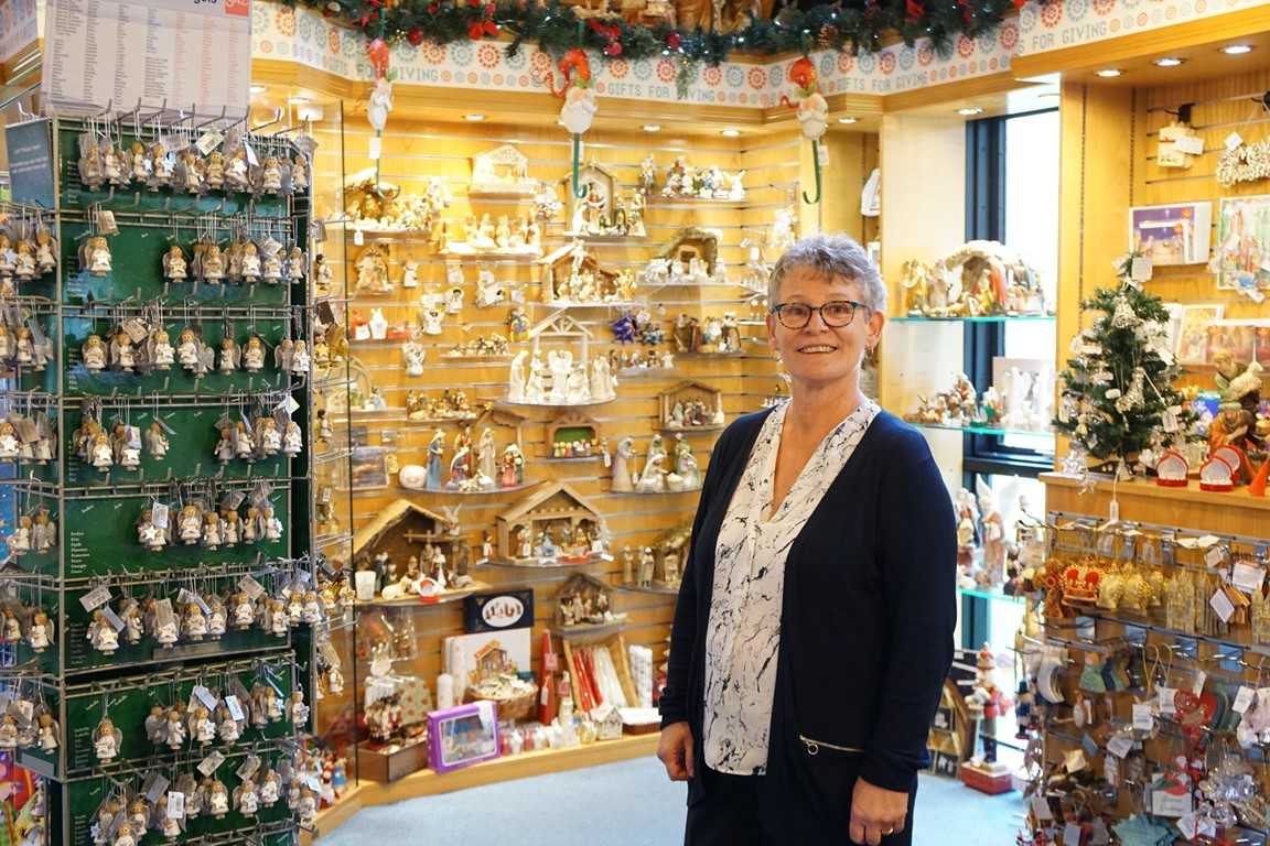 Truro Cathedral shop supervisor Celia Bray standing inside the shop