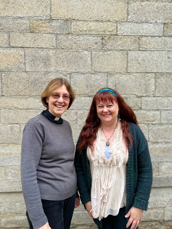 Ellen McKessock and Canon Lynda Barley standing outside the old cathedral school