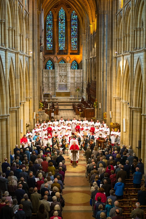 Ariel view of the nave with choir and orchestra and congregation at Truro Cathedral