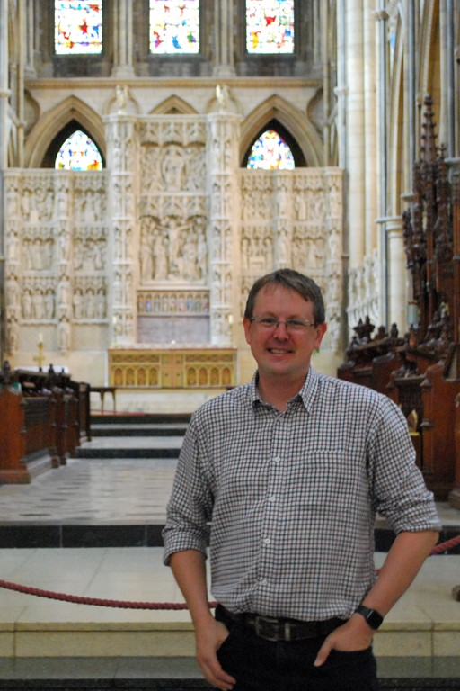 Sean O'Neill standing inside Truo Cathedral in front of the high altar