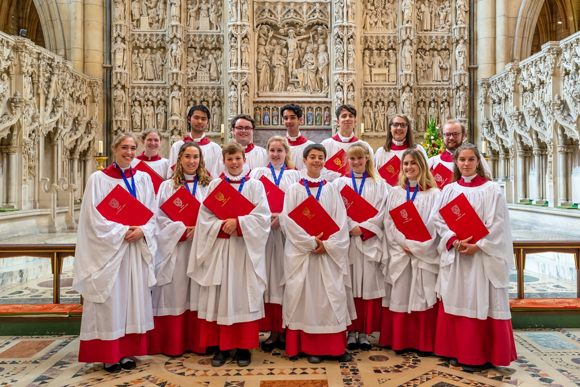 Members of Truro Cathedral choral foundation standing in front of the high altar in the cathedral