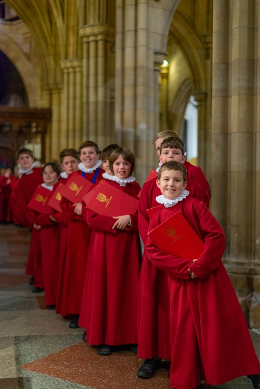 Truro Cathedral choristers standing inside the cathedral.