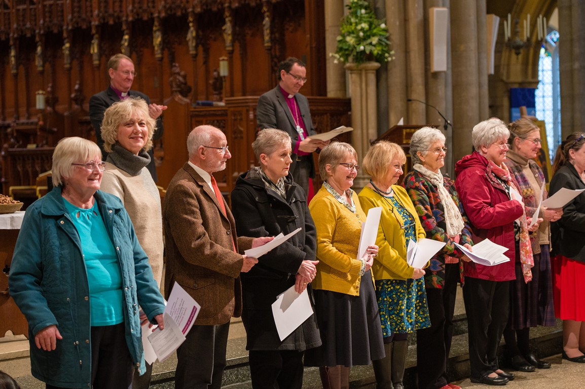 Newly accredited Lay Pastoral Ministers standing in Truro Cathedral