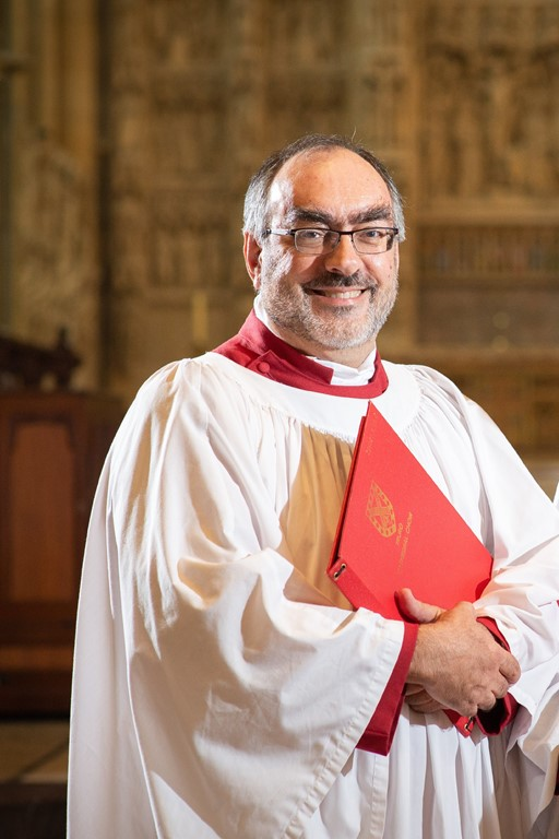Senior Lay Vicar Marc Gregory standing inside Truro Cathedral