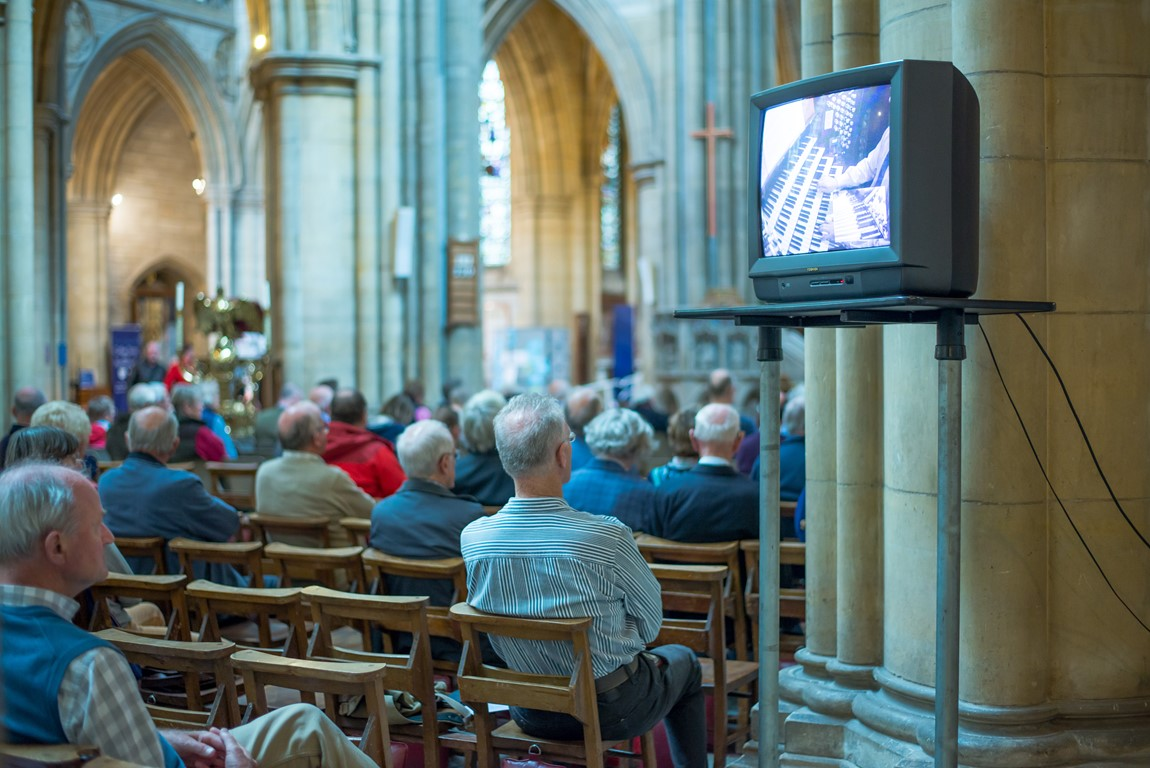 People sitting inside Truro Cathedral listening to a lunchtime organ recital