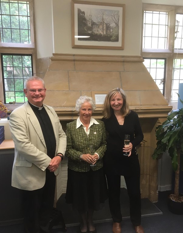 Dean Roger standing with Barbara Schmid and artist Jeanni Grant-Nelson in the Old Cathedral School building.