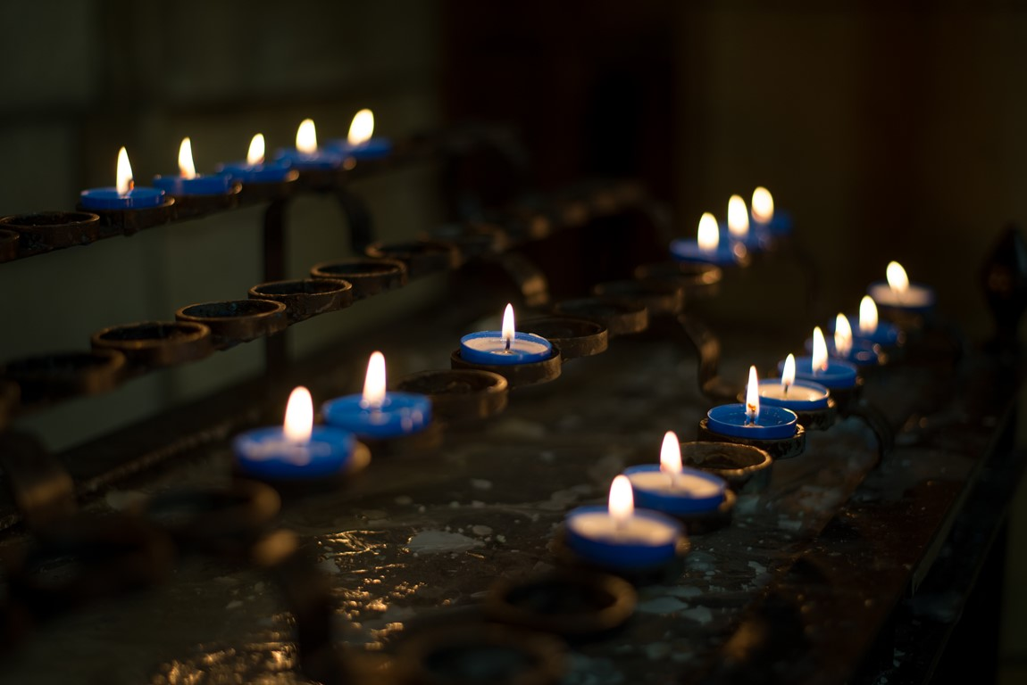 Close up of lit candles on the pricket stand in Truro Cathedral