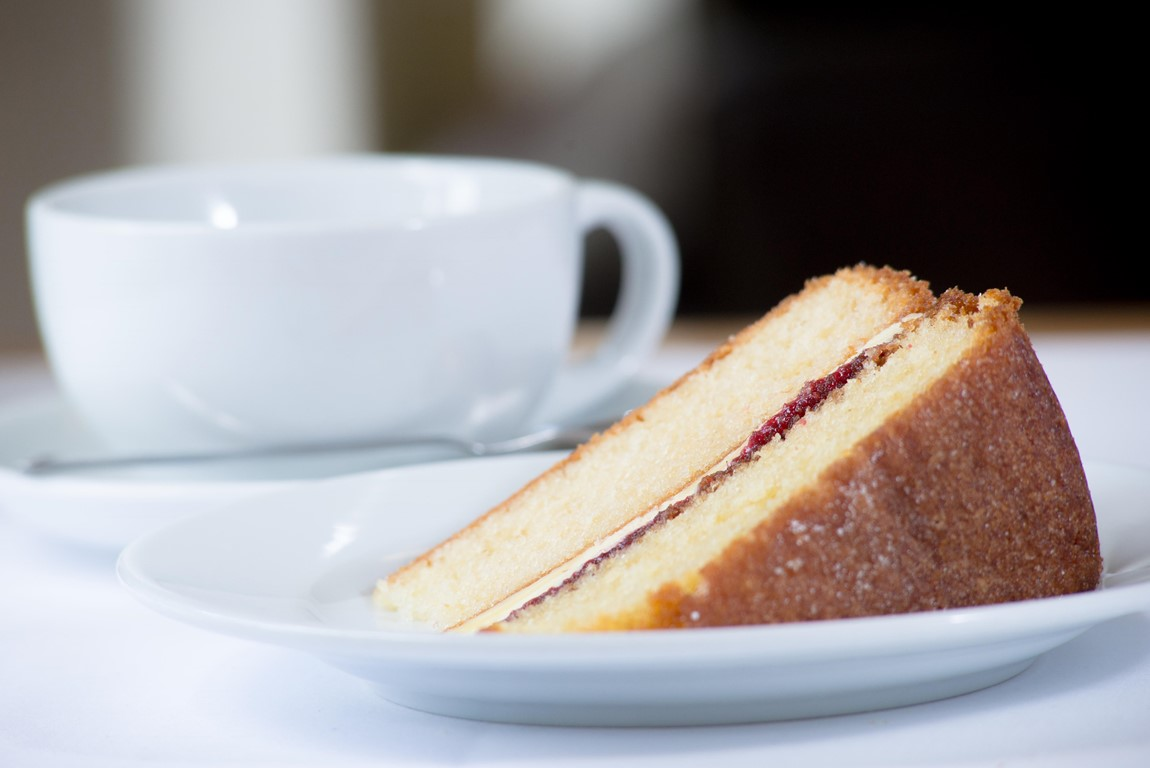 A slice of cake and a cup of tea