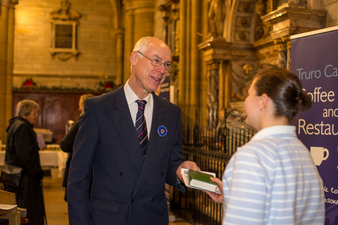 Truro Cathedral Steward greeting a member of the public